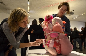 """Kate Woodliff O'Donnell and Sarah Wallace Scott Interacting with Viviane's """"Agglomerate 002"""" sculpture; the community donated pink fibers to Viviane"""